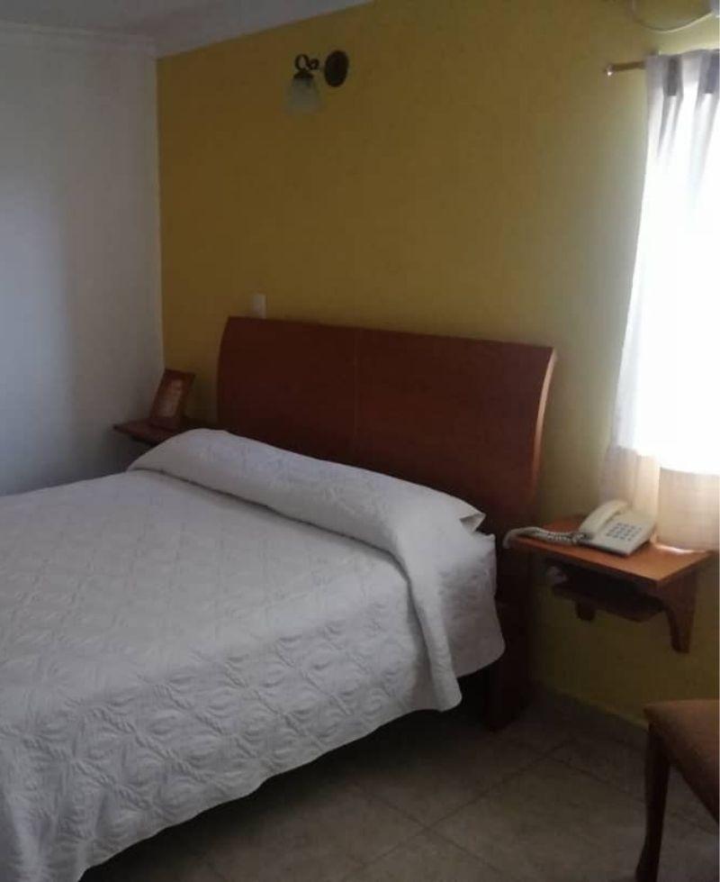 ana rosa habitación en posada san Cristóbal
